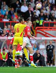 Bristol City's Aaron Wilbraham battles for the ball with Milton Keynes Dons' Antony Kay  - Photo mandatory by-line: Joe Meredith/JMP - Mobile: 07966 386802 - 27/09/2014 - SPORT - Football - Bristol - Ashton Gate - Bristol City v MK Dons - Sky Bet League One