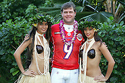 KO OLINA - FEBRUARY 10:  Oakland Raiders 2005 NFL Pro Bowl AFC All-Stars punter Shane Lechler #9 poses with Hawaiian Hula girls for his 2005 NFL Pro Bowl team photo on February 10, 2005 in Ko Olina, Hawaii. ©Paul Anthony Spinelli
