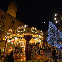 TREVISO, ITALY - DECEMBER 06:  A Christmas tree and a Merry-go-round are seen on December 6, 2011 in Treviso, Italy. Christmas Markets are popular in Northern Italian cities, selling festive items including lights, nativity scenes, decorations and local festive handicrafts. In most cities they will run from the end of November to January 6th. HOW TO LICENCE THIS PICTURE: please contact us via e-mail at sales@xianpix.com or call our offices in London   +44 (0)207 1939846 for prices and terms of copyright. First Use Only ,Editorial Use Only, All repros payable, No Archiving.© MARCO SECCHI