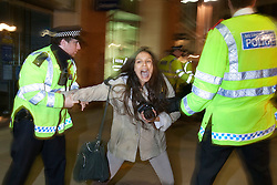 © licensed to London News Pictures. London, UK 01/05/2012. A protester being detained at Paternoster Square as Occupy London activists occupy parts of the London Stock Exchange and Paternoster Square as part of May Day protests in London. Photo credit: Tolga Akmen/LNP
