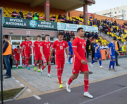 ORHEI, MOLDOVA - Friday, October 11, 2019: Wales' Brennan Johnson (L) and Benjamin Cabango (R) walk out before during the UEFA Under-21 Championship Italy 2019 Qualifying Group 9 match between Moldova and Wales at the Orhei District Sports Complex. (Pic by Kunjan Malde/Propaganda)