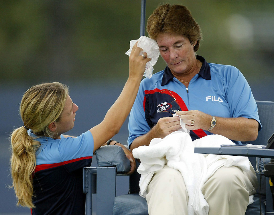 Chair umpire Lynn Welch of the US is helped by a ballgirl after she was stuck in the face by a ball thrown by a ballperson during the match between Ai Sugiyama of Japan and Francesca Schiavone of Italy Thursday 04 September, 2003 at the US Open in Flushing Meadows, NY. Andrew GOMBERT//