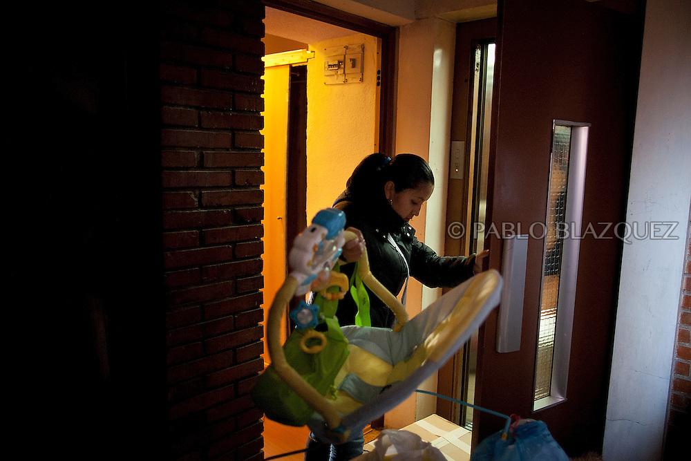 Patricia Tapia, 28, places her baby's cradle inside the lift while she waits to be evicted from her apartment on February 15, 2012 in Madrid, Spain. Tapia, an unemployed Ecuadorian mother of two, used to work at a mailing company but when she was six months pregnant the employer decided not to renew her contract and she could not afford to pay her mortgage. The anti-eviction organization 'Platform for People Affected by Mortgages' in Spain has called for a permanent halt to the evictions of families who are struggling to pay their debts because of the poor economic climate.