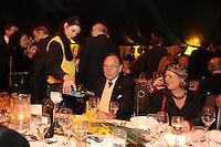 21 MAR 2007, BERLIN/GERMANY:<br /> Hans-Dietrich Genscher (M), FDP, Bundesaussenminister a.D., wird von Personal im gelben Pollover bedient, Feier zum 80. Geburtstag von Genscher, Zirkus Sarrasani, Hauptbahnhof<br /> IMAGE: 20070321-02-039<br /> KEYWORDS: Sarrasani-Zelt