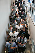 09/19/2014 - Medford, Mass. - The Tufts football team makes its way down to the locker room for practice in preparation of their season opener against Hamilton on Sept. 19, 2014. (Kelvin Ma/Tufts University)