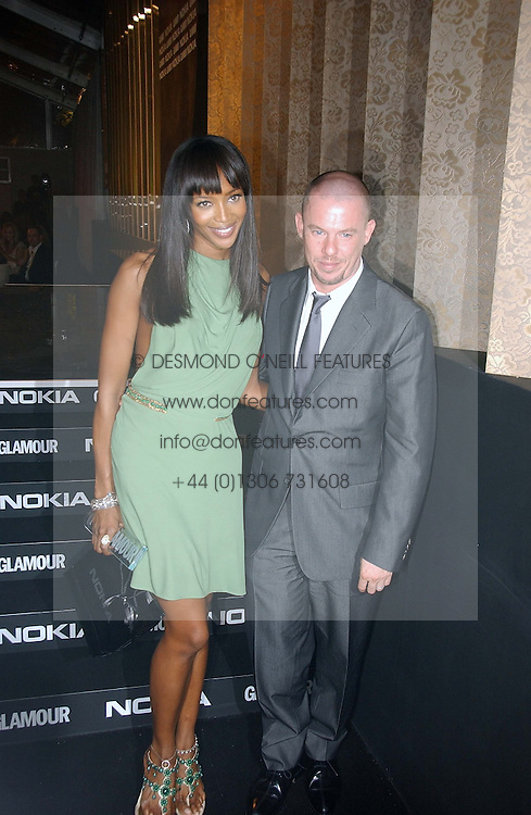 NAOMI CAMPBELL and ALEXANDER MCQUEEN at the 2006 Glamour Women of the Year Awards 2006 held in Berkeley Square Gardens, London W1 on 6th June 2006.<br />