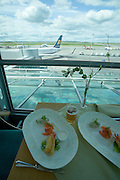 Deep fried shrimps, salmon and fish mousse at Vantaa airport. Icelandair Boeing 757-300 in the background.