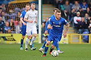 AFC Wimbledon midfielder Dean Parrett (18) dribbling and starting an attack during the EFL Sky Bet League 1 match between AFC Wimbledon and Northampton Town at the Cherry Red Records Stadium, Kingston, England on 11 March 2017. Photo by Matthew Redman.