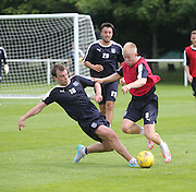 Paul McGowan tackles Dundee new boy Nicky Low - Dundee pre-season training at University grounds, Riverside<br /> <br />  - &copy; David Young - www.davidyoungphoto.co.uk - email: davidyoungphoto@gmail.com
