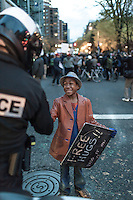 Devonte Hart and Portland, Oregon police officer Bret Barnum have their special moment.  Protest in front of the Justice Center to protest the Mike Brown, Ferguson verdict.  ©jan sonnenmair 2014.  All rights reserved.