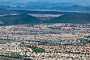 Track housing blankets the Phoenix suburbs and fills in the area's expansive valleys.  Zoned single-use suburban landscapes virtually necessitate a car, and enclave neighborhoods and culs-de-sac make it difficult to navigate through the area.