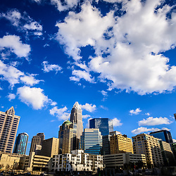 Charlotte skyline with a blue sky and clouds.  Includes One Wells Fargo Center, Two Wells Fargo Center, Bank of America Corporate Center, Bank of America Plaza, 121 West Trade building, and Carillon Tower. Charlotte, North Carolina is a major city in the Eastern United States of America