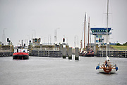 Nederland, Afsluitdijk Kornwerderzand, 4-6-2018 Het sluizencomplex aan de Friese kant van de Afsluitdijk. Hier wordt ook de zoetwaterpassage voor vissen uit de waddenzee gemaakt. Foto: Flip Franssen
