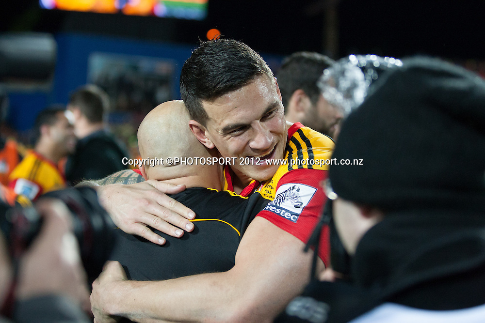 Chiefs' Sonny Bill Williams hugs team trainer Wally Rifle after the Investec Super Rugby final between Chiefs and Sharks won by Chiefs 37-6 at Waikato Stadium, Hamilton, New Zealand, Saturday 4 August 2012. Photo: Stephen Barker/Photosport.co.nz