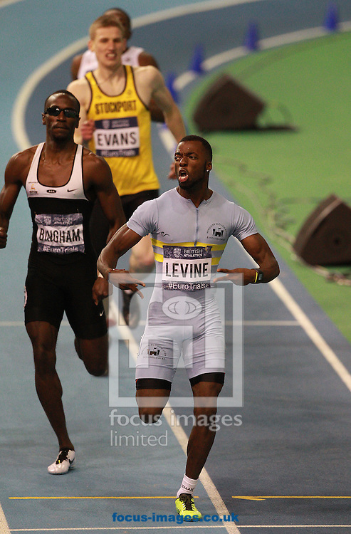 Picture by Paul Terry/Focus Images Ltd +44 7545 642257.10/02/2013.Nigel Levine ( R ) celebrates as he crosses the line to win the Mens 400 Metre final during the UK Championships at English Institute of Sport, Sheffield.