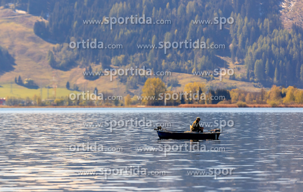 THEMENBILD - ein Angler mit seinem Boot beim fischen, aufgenommen am 30. April 2016, am Zeller See, Zell am See, Oesterreich // A man fishes on his boat on the Lake Zell, Zell am See, Austria on 2016/04/30. EXPA Pictures © 2016, PhotoCredit: EXPA/ JFK