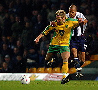 PICTURE BY DANIEL HAMBURY/SPORTSBEAT IMAGES<br /> Nationwide Football League Division One    2/3/04<br /> <br /> Norwich City V West Bromwich Albion<br /> <br /> Norwich City's Darren Huckerby and West Brom's James Chambers
