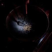 """Brasile, Amazzonia, garimpo de Juma. Le miniere a cielo aperto del garimpo de Juma, dove la vita dei minatori scorre tra pericolo per un lavoro al limite e deforestazione incontrollata. Aspettando di trovare l'oro che cambi la loro vita. In questa foto il momento in cui l'oro viene """"cucinato"""" per dividerlo dal mercurio. Brazil, Amazonia, garimpo de Juma. The open pit mines of garimpo de Juma, where the miners work flows between danger and uncontrolled deforestation. Waiting to find the gold that changes their lives. In this picture the time when the gold is """"cooked"""" to divide by mercury."""