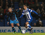 Brighton striker Anthony Knockaert gets the better of Sheffield Wednesday midfielder Barry Bannan  during the Sky Bet Championship match between Brighton and Hove Albion and Sheffield Wednesday at the American Express Community Stadium, Brighton and Hove, England on 8 March 2016. Photo by Bennett Dean.