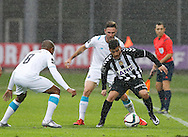 Portugal, FUNCHAL : Nacional´s Portuguese defender João Aurélio (L)  controls the ball during the Portuguese league football match Nacional vs F.C. Porto at the Madeira stadium in Funchal on December 13, 2015.  LUSA / GREGORIO CUNHA