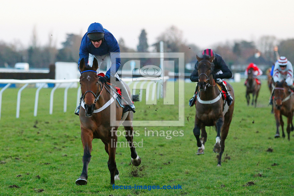 Barry Geraghty(blue colours) riding Ok Corral winning the Watch On Racing UK App Handicap Chase at Kempton Park, Sunbury<br /> Picture by John Hoy/Focus Images Ltd +44 7516660607<br /> 06/02/2015