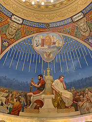 """The vestibule ceiling contains brightly painted murals by Pusterla and his assistants painted in a """"grand Italian decorative style"""" (nytimes). The subject of these murals is the administration of justice, and the murals depict many allegorical figures representing Truth, Error, Protection, Security, Army and Navy among others.<br /> <br /> The rotunda is even more dramatic. The Historical Society of the New York Courts describes the rotunda: """"[it] is 200 feet in circumference and rises 75 feet to a cupola 30 feet in height, 20 feet across, with 10 stained glass windows and clerestory. It was not until the mid-1930s, however, that work commenced on the renowned Courthouse murals"""" (nycourts.gov). These murals were completed by Pusterla and his assistants between 1934 and 1936 and depict the history of law. The six lunettes """"depict the law across different civilizations.  Assyrian and Egyptian, Hebraic and Persian, Greek and Roman, Byzantine and Frankish, English and American civilizations are illustrated on the six lunettes. Above the seated figures are portraits of six lawgivers: Hammurabi, Moses, Solomon, Justinian, Blackstone and John Marshall"""" (untappedcities.com)."""