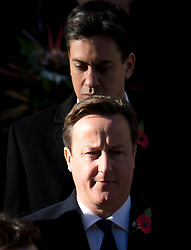 © London News Pictures. 10/11/2013. London, UK. British Prime Minister David Cameron (front) and Labour Party leader Ed Miliband (back) attend a Remembrance Day Ceremony at the Cenotaph war memorial in London, United Kingdom, on November 10, 2013 . Royalty and Politicians joined the rest of the county in honouring the war dead by gathering at the iconic memorial to lay wreaths and observe two minutes silence. Photo Credit: Ben Cawthra/LNP