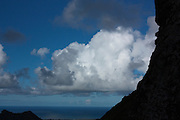 Cumulus clouds against a blue sky over the ocean in Hawaii