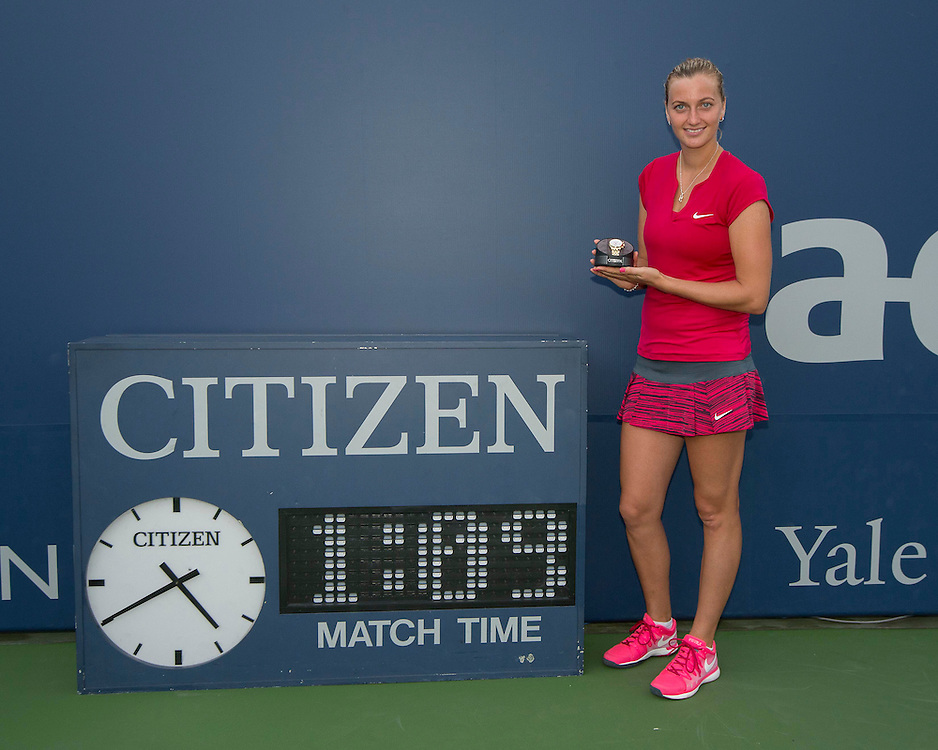 August 23, 2014, New Haven, CT:<br /> Singles Champion Petra Kvitova poses for a photograph next to the Citizen match clock during a ceremony following the Singles Final on day nine of the 2014 Connecticut Open at the Yale University Tennis Center in New Haven, Connecticut Saturday, August 23, 2014.<br /> (Photo by Billie Weiss/Connecticut Open)