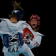 Franka Anic, Slovenia, (red) in action against Gulnafis Aitmukhambetova, Kazakhstan, during the Taekwondo Women 67kg preliminary round during the London 2012 Olympic games. London, UK. 10th August 2012.