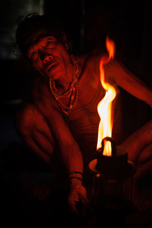 Mentawai man behind flame