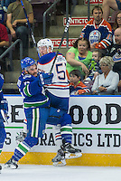 PENTICTON, CANADA - SEPTEMBER 16: Yan-Pavel Laplante #74 of Vancouver Canucks checks Collin Shirley #57 of Edmonton Oilers into the boards on September 16, 2016 at the South Okanagan Event Centre in Penticton, British Columbia, Canada.  (Photo by Marissa Baecker/Shoot the Breeze)  *** Local Caption *** Collin Shirley; Yan-Pavel Laplante;