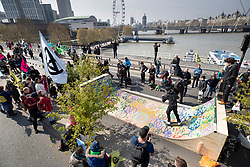 © Licensed to London News Pictures. 15/04/2019. London, UK. A temporary skate park has been erected as Extinction Rebellion members block Waterloo Bridge during a day of coordinated actions and demonstrations  throughout London and other UK cities to highlight global climate change. Photo credit: Peter Macdiarmid/LNP