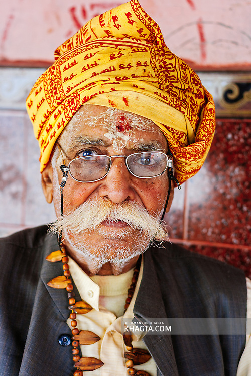 A Hindu saint sitting in a temple in Vishram Ghat Mathura. Mathura is a sacred town situated on the banks of Yahuman river in Uttar Pradesh, northern India. The birthplace of the deity Lord Krishna. It is a pilgrimage site for Hindus.