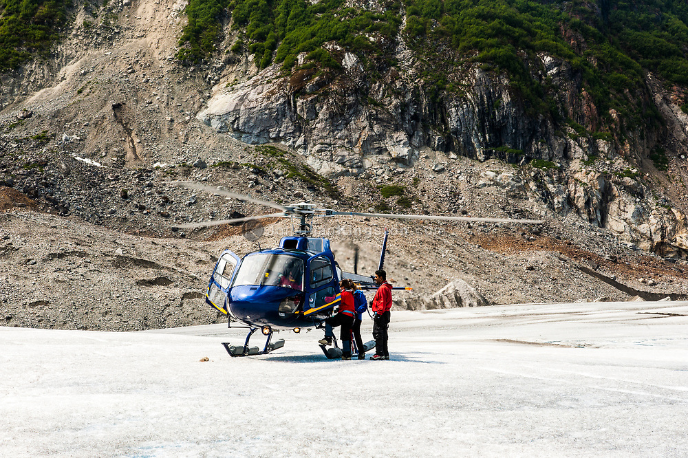 A helicopter preparing for take off on the Juneau Icefield, Alaska.