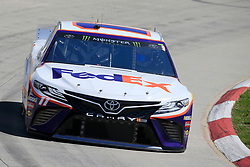 March 23, 2019 - Martinsville, VA, U.S. - MARTINSVILLE, VA - MARCH 23: #11: Denny Hamlin, Joe Gibbs Racing, Toyota Camry FedEx Ground during final practice for the STP 500 Monster Energy NASCAR Cup Series race on March 23, 2019 at the Martinsville Speedway in Martinsville, VA.  (Photo by David J. Griffin/Icon Sportswire) (Credit Image: © David J. Griffin/Icon SMI via ZUMA Press)