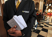 35559258© Licensed to London News Pictures. 28/10/2011. London, UK.  A member of staff holds the order of service booklets. A Eucharist service held at St Paul's Cathedral today. St Paul's Cathedral reopened its doors at midday today. The Cathedral had been closed over health and safety fears from the Occupy London protest outside.  Photo: Stephen Simpson/LNP