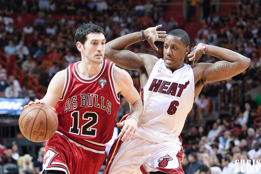 12 March 2010: Chicago Bulls guard Kirk Hinrich drives past Miami Heat guard Mario Chalmers during the Miami Heat 108-95 victory over the Chicago Bulls at the AmericanAirlines  Arena, in Miami, Florida, USA.