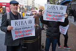 London, UK. 8 October, 2019. Campaigners from Architects for Social Housing (ASH) protest outside the award ceremony for the Riba Stirling Prize at the Roundhouse. ASH were protesting against the Royal Institute of British Architects' (RIBA) nomination of the architecture of social cleansing, estate demolition and housing privatisation for the Stirling Prize, against the false promotion of council-owned commercial housing development and management companies as a so-called 'renaissance in social housing' and against the association of the name of socially committed architect, the late Neave Brown, with the architecture of Neo-liberalism. Credit: Mark Kerrison/Alamy Live News