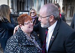 © Licensed to London News Pictures. 18/12/2019. London, UK. Relatives and survivors of the 1982 IRA Hyde Park Bomb Vincenzo Latino and SarahJane Young hug each other at The High Court where they  and other family memberss have won a ruling in a civil case against convicted IRA member John Downey. The court has ruled that John Downey was an active participant in the bombing.  The Hyde Park bombing in July 1982 killed Squadron Quartermaster Corporal Roy Bright, Lieutenant Anthony Daly, Lance Corporal Jeffrey Young and Trooper Simon Tipper. Photo credit: Peter Macdiarmid/LNP