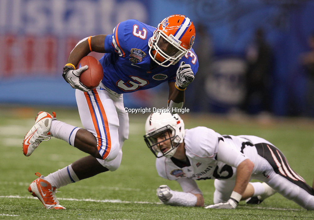 Jan 01, 2010; New Orleans, LA, USA;  Florida Gators running back Chris Rainey (3) runs after a catch against the Cincinnati Bearcats during the first half of the 2010 Sugar Bowl at the Louisiana Superdome.  Mandatory Credit: Derick E. Hingle-US PRESSWIRE.