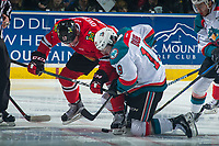 KELOWNA, CANADA - APRIL 7: Alex Overhardt #17 of the Portland Winterhawks digs for the puck against Dillon Dube #19 of the Kelowna Rockets on April 7, 2017 at Prospera Place in Kelowna, British Columbia, Canada.  (Photo by Marissa Baecker/Shoot the Breeze)  *** Local Caption ***