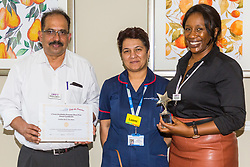 Care UK's Franklin House care home in West Drayton, London, has been awarded a Two Years Pressure Prevention Award from North West London NHS Foundation, in collaboration with Hillingdon TVN Team and Hillingdon CCG Home Manager Matthew V Matthew poses with Luxmi from TVN Team and Hillingdon CCG and Care UK Regional Director Vivien Ziwocha, right, after the award presentation. London, July 11 2019.