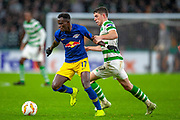 Ryan Christie (#17) of Celtic FC pulls back Bruma (#17) of RB Leipzig during the Europa League group stage match between Celtic and RP Leipzig at Celtic Park, Glasgow, Scotland on 8 November 2018.