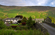 Grange and Maiden Moor, Cumbria.  Houses and the small church in the hamlet of Grange from the historic stone bridge over the River Derwent.