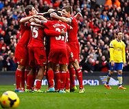 Daniel Sturridge of Liverpool (15) celebrates scoring his first goal of the game with team mates during the Barclays Premier League match at Anfield, Liverpool<br /> Picture by David Horn/Focus Images Ltd +44 7545 970036<br /> 08/02/2014