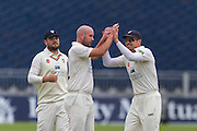 Chris Rushworth (Durham County Cricket Club) celebrates with team mates after taking the wicket of Chris Woakes (Warwickshire County Cricket Club) during the LV County Championship Div 1 match between Durham County Cricket Club and Warwickshire County Cricket Club at the Emirates Durham ICG Ground, Chester-le-Street, United Kingdom on 14 July 2015. Photo by George Ledger.