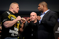 November 11, 2011; Santa Monica, CA; USA; Former UFC heavyweight champion Brock Lesnar (l) and Alistar Overeem (r) pose after the press conference announcing their upcoming fight.  The two will meet on December 30, 2011 in the main event at the MGM Grand Garden Arena in Las Vegas