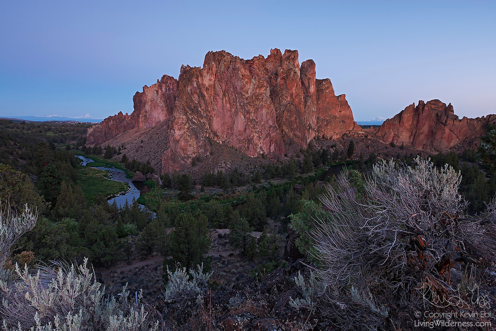 The Crooked River winds around Smith Rock located near Redmond, Oregon. Several of the Cascade Mountains are visible on the horizon: from left to right, The Sisters, Mount Washington and Mount Jefferson (in the gap at right).