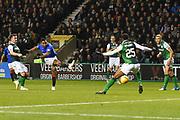 Alfredo Morelos' shot is blocked by Efe Ambrose during the Ladbrokes Scottish Premiership match between Hibernian and Rangers at Easter Road, Edinburgh, Scotland on 19 December 2018.